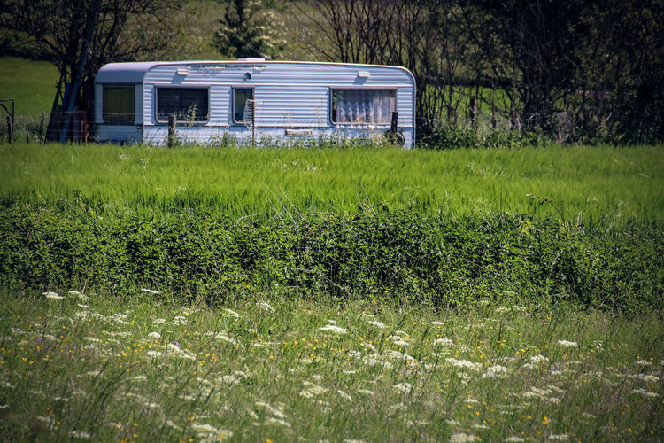 Agriculture Architecture Beauty In Nature Building Exterior Built Structure Caravan Day Field Grass Green Color Growth Landscape Nature No People Outdoors Rural Scene Tree