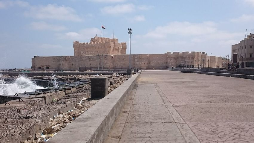 Castle of salah eldin Alexandria Castle Egypt Historical Building Relaxing Architecture Building Exterior Built Structure City Clam Cloud - Sky Day Flag History Motion Nature No People Outdoors Patriotism Sea Sea Waves Sky Water Waves Waves And Rocks