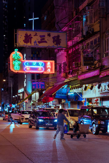 Kowloon City KowloonCity Neon Neonlights Neon Lights Neon Sign Neon Colored One Person Old Buildings Cyberpunk Bladerunner EyeEm Best Shots EyeEm Selects EyeEm Gallery City Illuminated Street Transportation Building Exterior Motor Vehicle Architecture Mode Of Transportation Night Car Built Structure Road City Life Land Vehicle Sign Group Of People City Street Men Real People Motion Outdoors