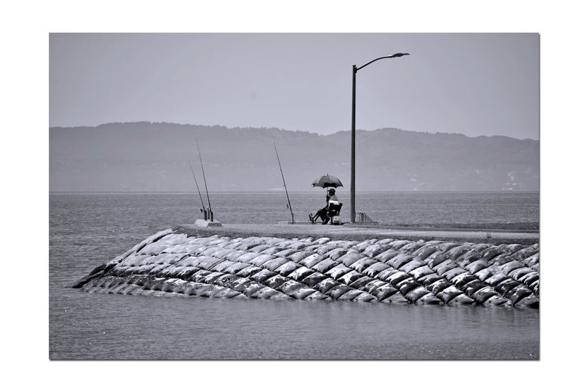 Gone Fishing 4 San Leandro Marina Bank San Leandro, Ca. Fishing Poles People Fishing Marina Channel Water Umbrella Lamppost Sand Bagged Channel Bank Marin Headlands San Francisco Bay Landscape Landscape_Collection Landscape_photography Nature Beauty In Nature Nature_collection Monochrome_Photography Monochrome Black & White Black & White Photography Black And White Collection  Black And White