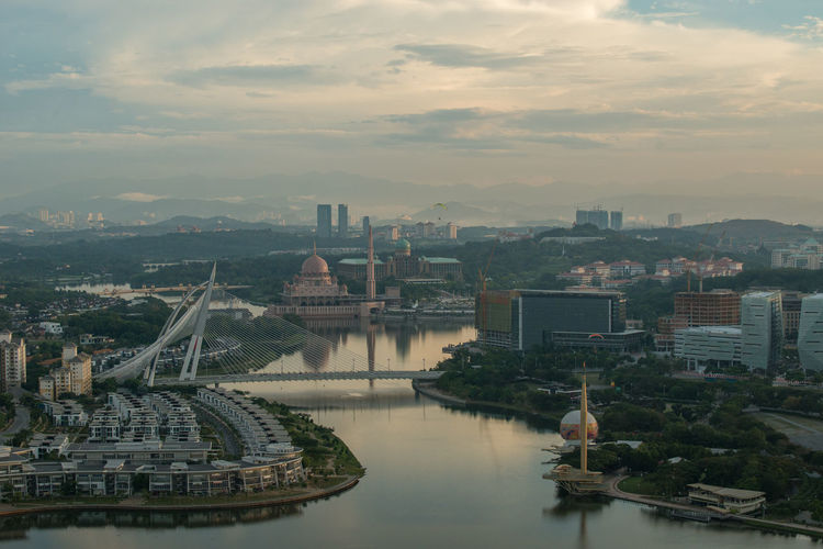 Putrajaya, Malaysia - Jan 14, 2017: Aerial view of Putrajaya, Malaysia and surrounding area of Putrajaya. Photo was taken in the morning from a powered paragliding (ppg) ride Aerial View Architecture Background Building Cloud Landmark Landscape Malaysia Modern Morning Light Morning Sky Putrajaya Scenics Sky Tourism Travel Water