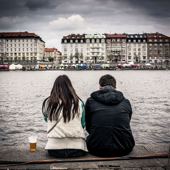 A Couple at the River 35mm 35mm Camera Adult Beer Bonding City Cloud - Sky Couple Couple - Relationship Czech Republic Europe Friendship Leisure Activity Naplavka People Prague Prague Czech Republic Real People Rear View Sitting Togetherness Two People Vltava Warm Clothing Water