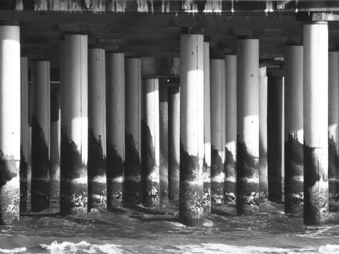 Northsea Low Tide Scheveningen Pier Scheveningenbeach Scheveningen  Schwarzweiß Black And White Blackandwhite Architectural Column Architecture Built Structure Water In A Row Day No People
