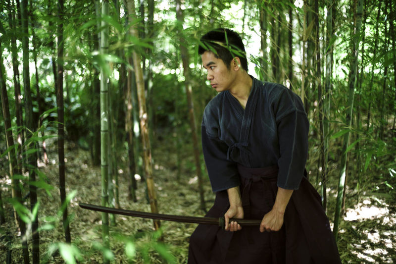 The modern samurai. Adult Adults Only Day Forest Lifestyles Men Nature One Man Only One Person Only Men Outdoors People Real People Standing Tree Young Adult