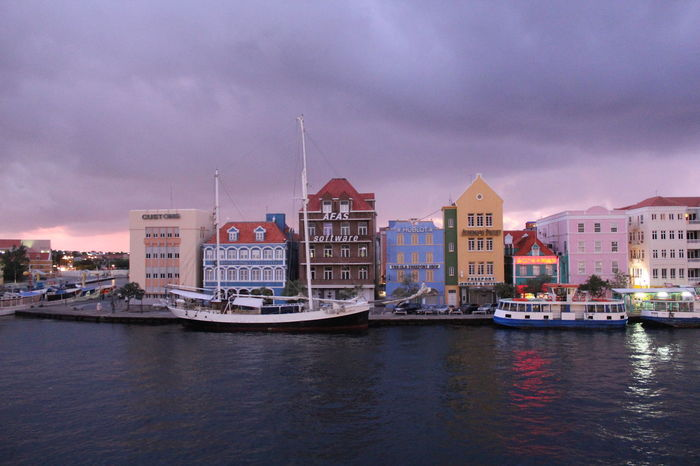 Willemstad on Curacao at Dawn Architecture At Dawn  Before Sunrise Building Exterior Built Structure Caribbean Architecture Caribbean At Night Caribbean Cruise Caribbean Cruise Ports Caribbean Island Caribbean Night Colorful Houses Curacao Day Nature No People Outdoors Punda Purple Clouds Purple Dawn Sky Typical Caribbean Water Willemstad