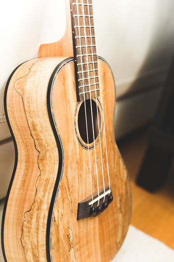 EyeEmNewHere Hawaiian Music Acoustic Guitar Arts Culture And Entertainment Classical Guitar Close-up Day Fretboard Guitar Hawaiian Music Musical Equipment Musical Instrument Musical Instrument String No People Still Life String Instrument Ukelele Wood - Material Woodwind Instrument