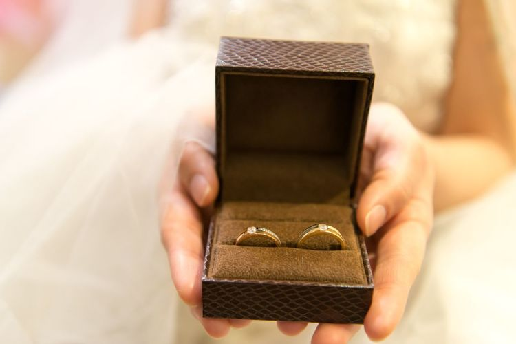 Holding Adult One Person Human Hand Hand Human Body Part Ring Midsection Wealth Jewelry Box - Container Box Technology Jewelry Box Gold Focus On Foreground Gold Colored Container Communication Luxury