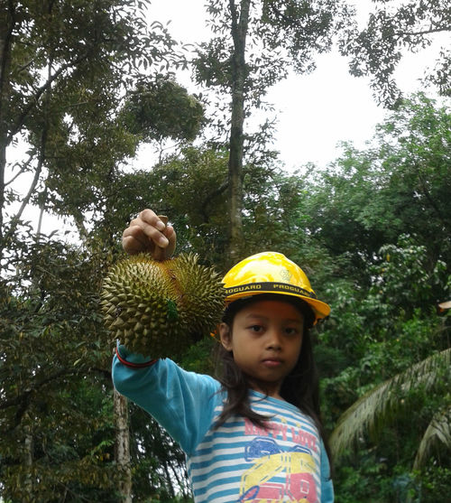 Durian Casual Clothing Childhood Day Durian Farm Elementary Age Girl Leisure Activity Nature One Person Outdoors Real People Saftyfirst Tree