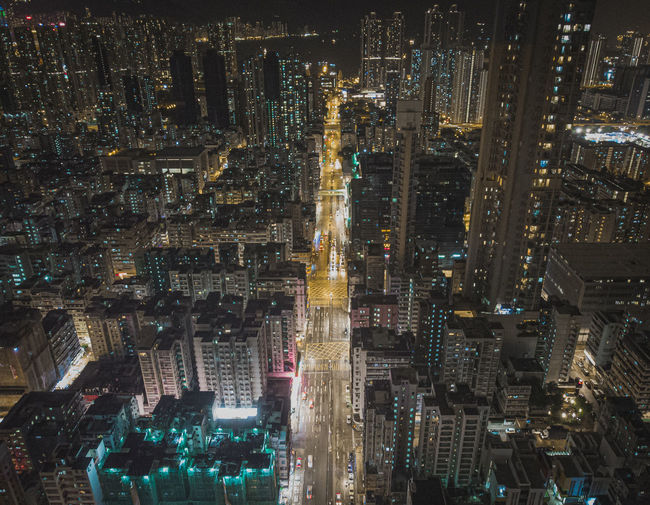 Aerial view of illuminated modern buildings in city at night