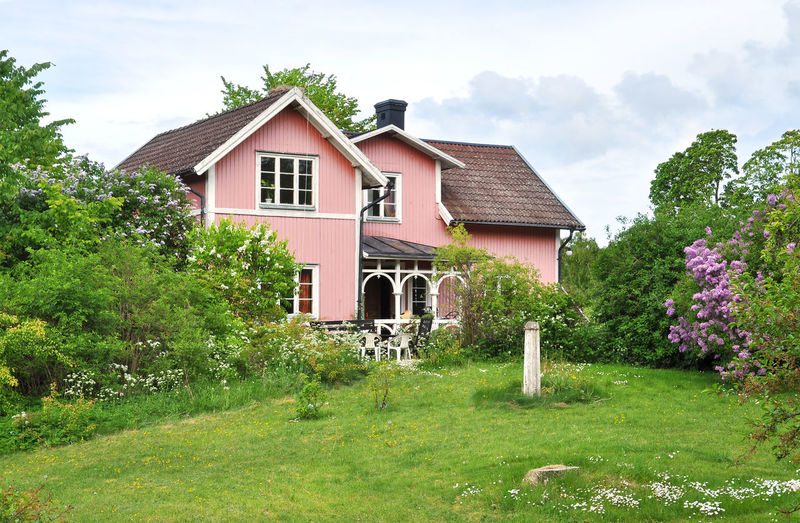 Pink house with garden Heda Houses Pink Sweden Architecture Building Exterior Built Structure Day Detached House Garden Grass House Nature No People Outdoors Plant Sky Tree