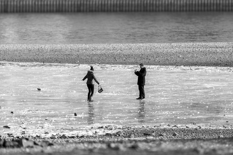 Duesseldorf, Germany Day Düsseldorf Eis Eisfläche Frozen Surface Ice Iced Icy Icy Day Icy Water Outdoors Paar Pair People Pärchen Real People Rhein Rheinufer Skating Two People Water