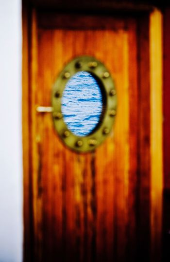 Port Hole Door Porthole Reflection Water Ocean Wooden