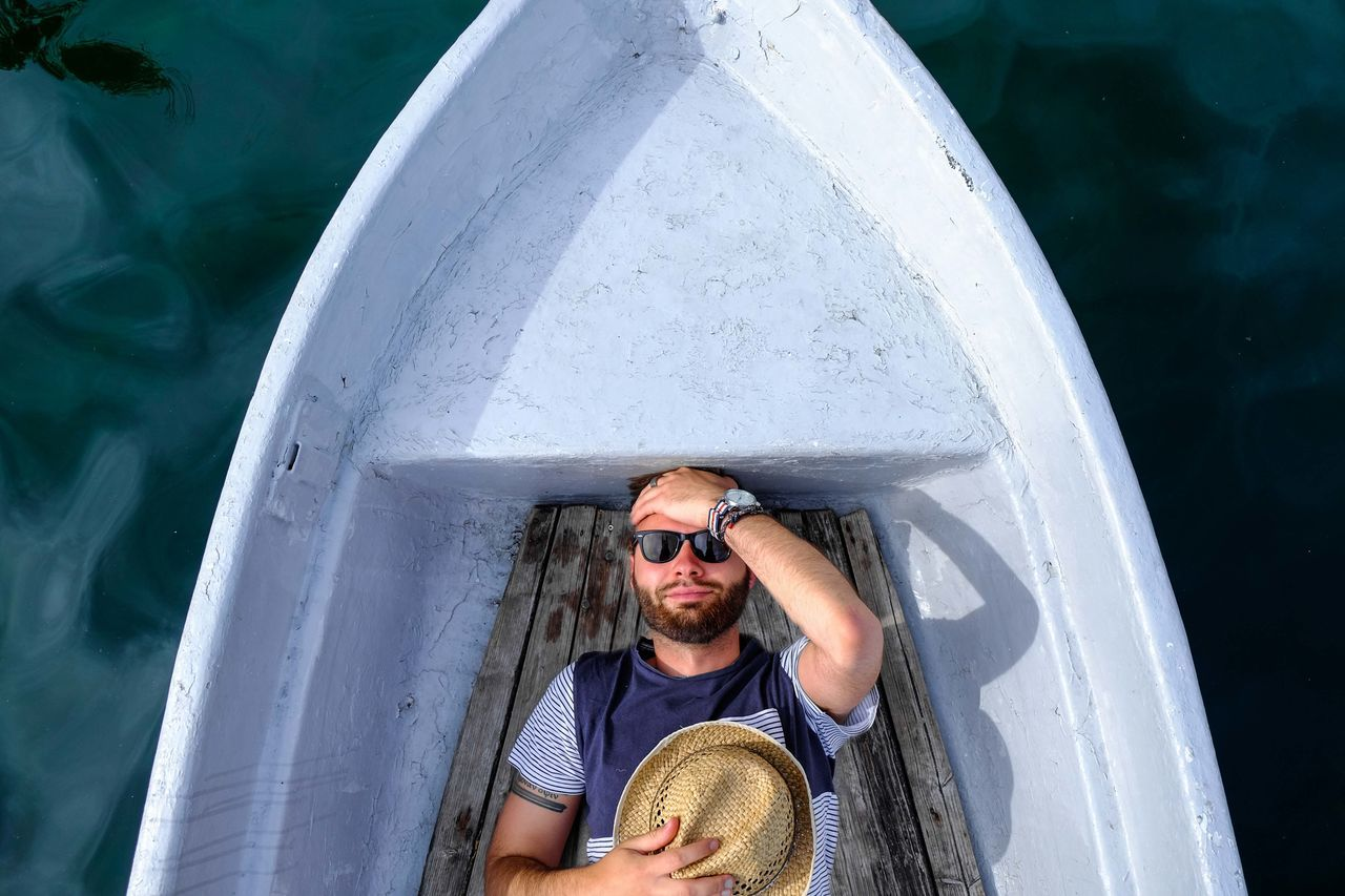 Directly Above Shot Of Man Sleeping In Boat