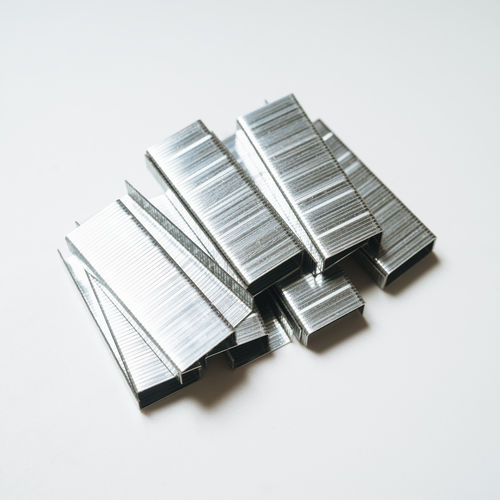 High Angle View Stack Order Publication Silver Colored Stapler Gray White Background Large Group Of Objects Close-up Metal Staple