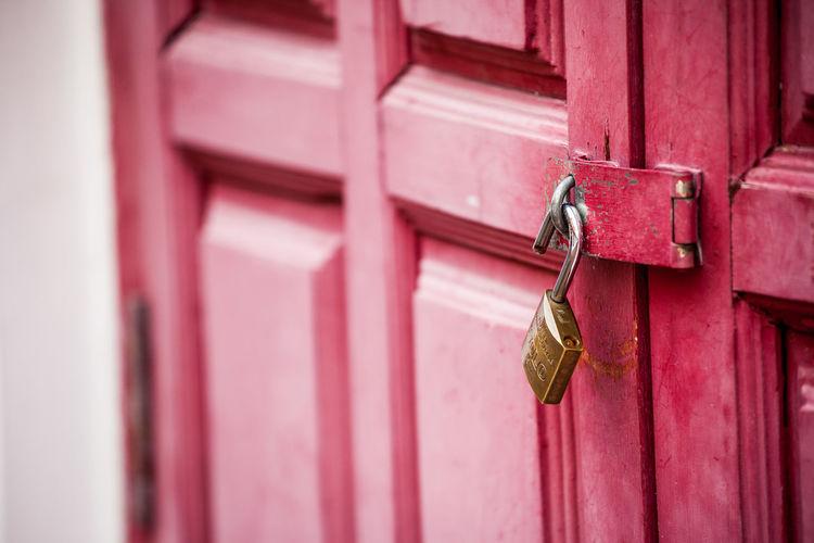 Close-Up Of Padlocks On Door