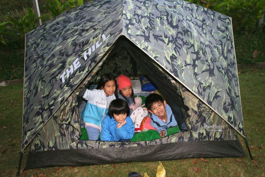 Child Girls Togetherness Family Childhood Boys Lifestyles Smiling Black Hair Full Length Enjoyment Thai Children Casual Clothing Medium Group Of People Tent Camping Children Only Thai Kid