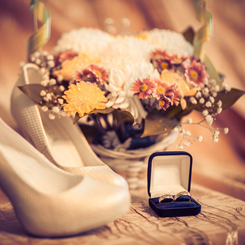 Close-Up Of Rink With Shoes And Bouquet On Table