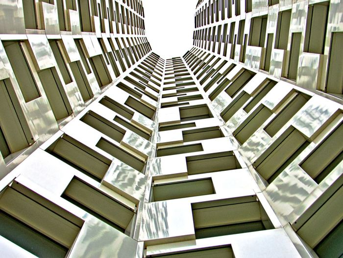 Architecture Built Structure Building No People Building Exterior Pattern Low Angle View Modern City Tall - High Office Building Exterior Repetition Outdoors In A Row Directly Below Full Frame Apartment Skyscraper Tower Day Geometric Shape