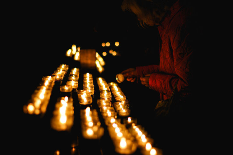Old lady lights a candle in a church Illuminated Indoors  Night Lighting Equipment One Person Close-up Human Hand Hand Human Body Part Glowing Light - Natural Phenomenon Dark Black Background Real People Selective Focus Darkroom Unrecognizable Person Woman Old Lady Church Candles Candlelight Prayer Religion Faith My Best Photo