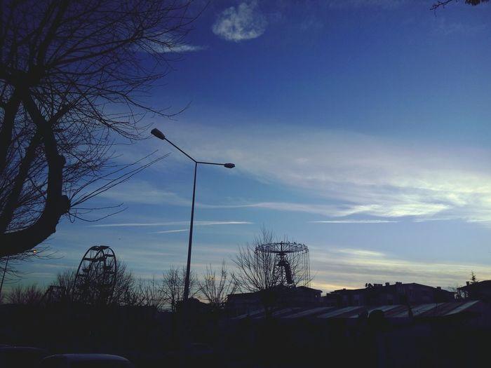 Sadness Lunapark Dönme Dolap Wolking Dark Kırklareli Beautiful Sky Sky Blues Blueandwhite Peaceful Akşamüzeri Tree Way Yolda Yururken Huzur