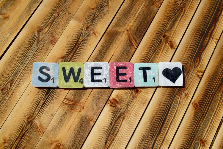 Text Typography Letters Information Outdoors Sweetheart Sweet♡ Communication Text No People Close-up Western Script High Angle View Full Frame Backgrounds Still Life Directly Above Wood - Material Brown Side By Side Group Of Objects