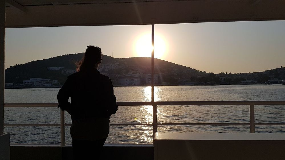 Silhouette Sunset Standing One Person Adults Only One Woman Only Adult People Rear View Only Women Travel Scenics Tranquility Vacations Travel Destinations My Dream Sky Horizon Over Water EyeEmNewHere Lost In The Landscape Ship Day Nature Lifestyles Sea Landscape Connected By Travel