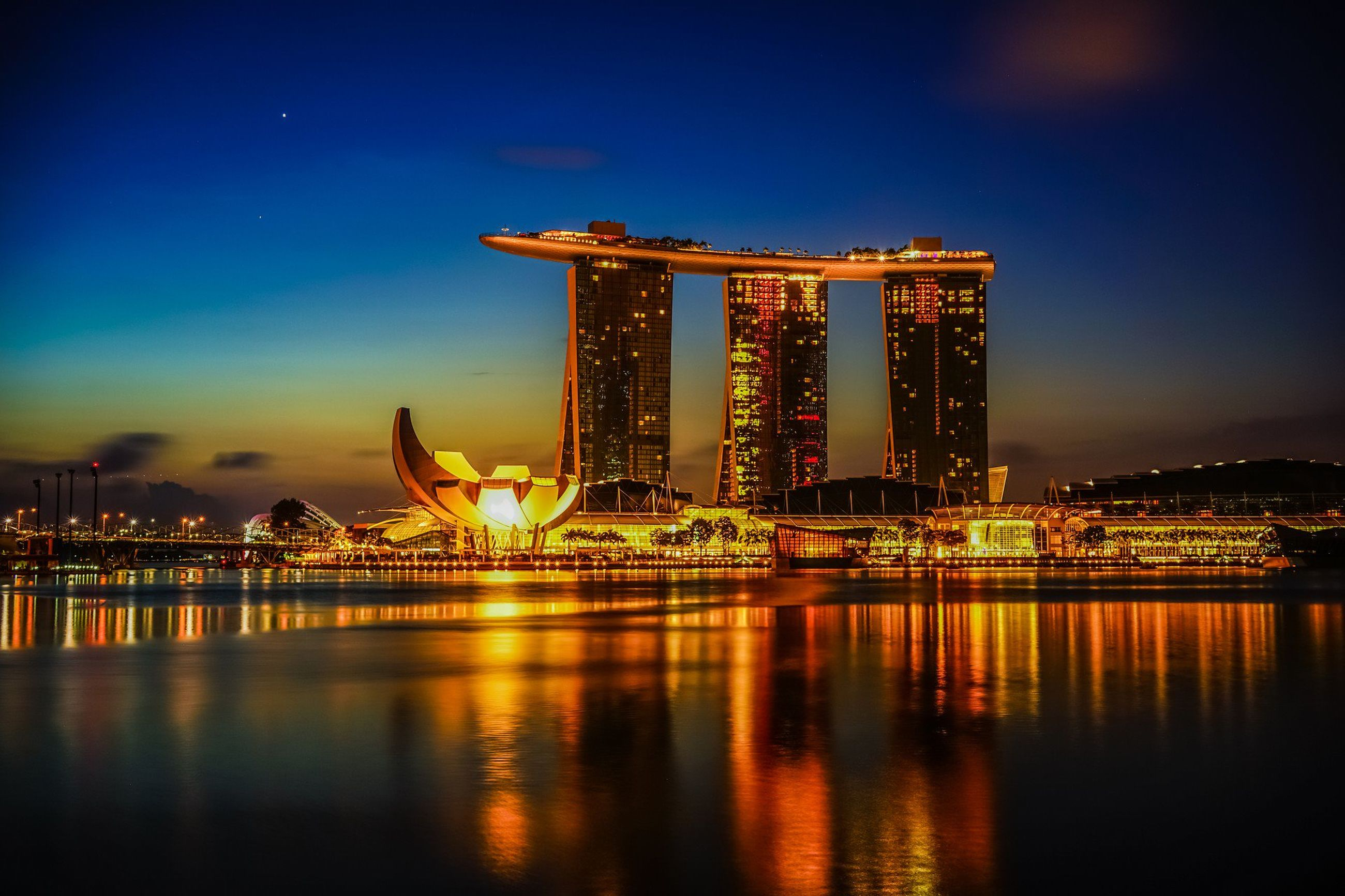 illuminated, night, water, architecture, built structure, reflection, waterfront, sky, river, bridge - man made structure, travel destinations, connection, city, famous place, dusk, building exterior, engineering, travel, capital cities, tourism
