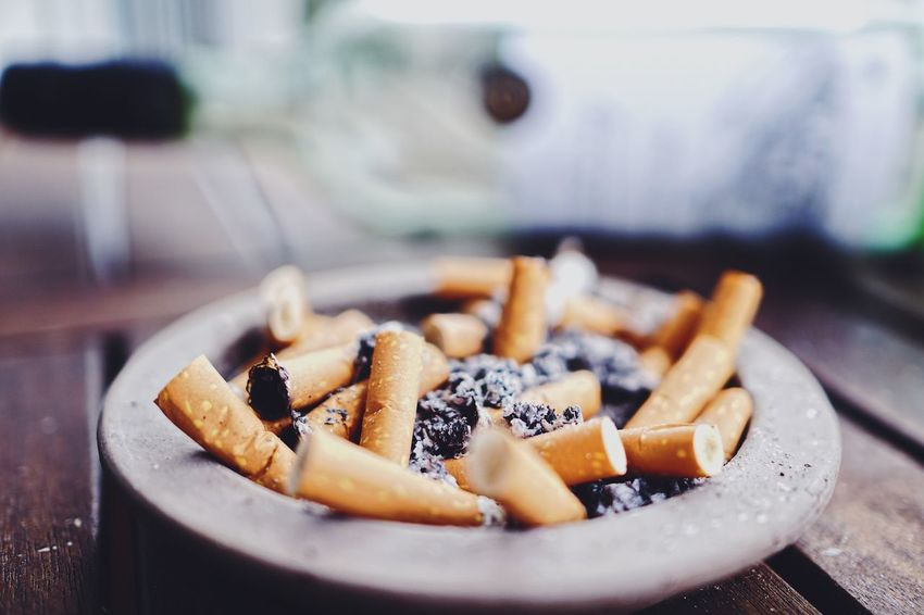 The Still Life Photographer - 2018 EyeEm Awards EyeEmNewHere Art Minimalism Nom Nom Nom EyeEm Selects Ashtray  Indoors  Close-up Focus On Foreground Social Issues Cigarette  Cigarette Butt Warning Sign Bad Habit RISK Sign No People Smoking Issues Still Life Communication Table Large Group Of Objects Selective Focus The Still Life Photographer - 2018 EyeEm Awards