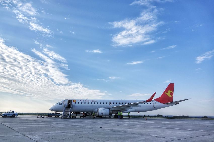 China Photos Airplane Airport Apron Transportation Cloud - Sky Rural Scene Business Finance And Industry Technology Commercial Airplane Airport Runway Aerospace Industry Sky Air Vehicle Day Outdoors No People Tianjin Airlines Landscape Scenics Travel Destinations Travel Streamzoofamily
