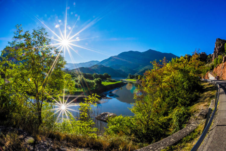 Morning Refelctions Bushes And Trees Country Green Road Sun Star Tree Blue Sky Early Morning Europe Italy Meetings Mountains And Sky Refelections Shrubbery Sunrise_sunsets_aroundworld Trees And Sky