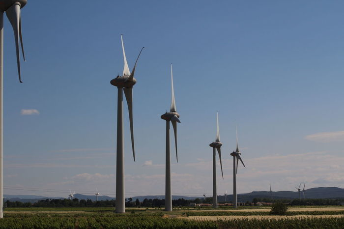Wind Turbines in the French Countryside From A Train Window Energy Power Generator Kinetic Sustainable Renewable Energy