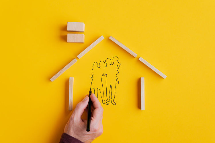 High angle view of human hand holding yellow paper