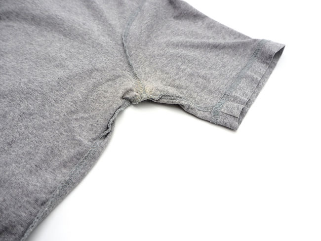 Yellow stain under armpit on T-shirt isolated on white background. White Background Studio Shot Indoors  No People Textile Close-up Copy Space White Color Cut Out Still Life Casual Clothing Body Part Single Object Crumpled Material High Angle View Gray Simplicity Textured  Detail