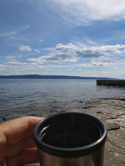 A nice cup of coffee Lake View Lakeshore Lakeside Lake Relaxing Swimming Coffee Outdoors Summer July Food And Drink Human Hand Horizon Over Water Nature Beach