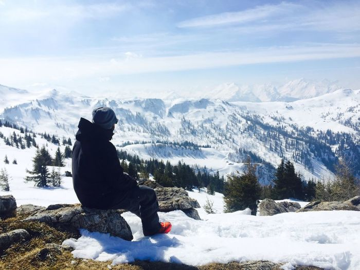 Side View Of A Man Overlooking Snowed Landscape