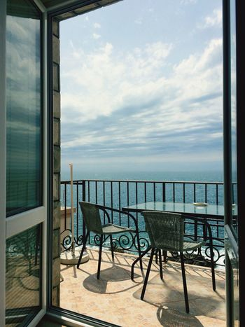 Leisure vacation Sea Window Horizon Over Water Water Sky Day Table Chair No People Scenics Nature Indoors