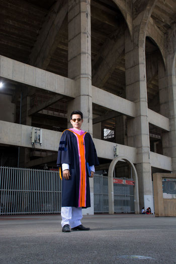 Uniform Architectural Column Success Men Real People Arch Adult Confidence  Day Building Exterior Achievement Young Adult Looking At Camera Portrait Clothing Built Structure Standing Front View Full Length One Person Architecture Graduation