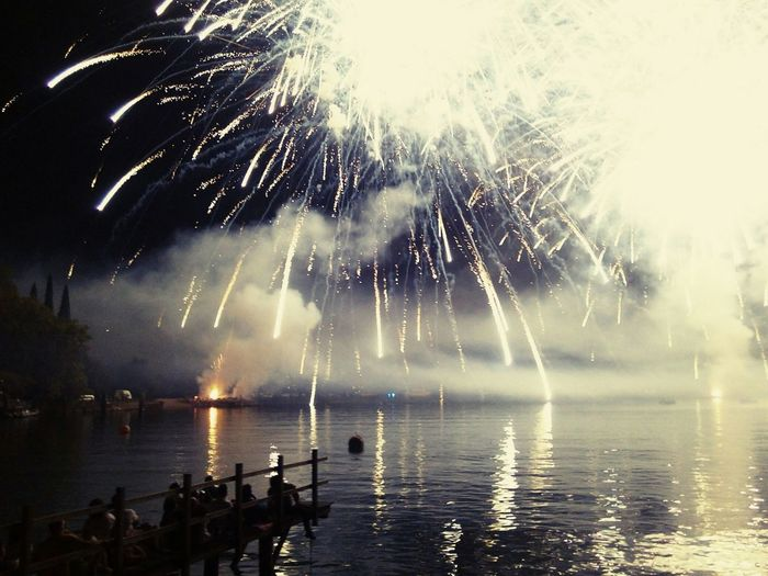 Enjoying The View of Fireworks On The Beach duringNotte Di Fiaba on the Garda Lake Italy Fireworksphotography