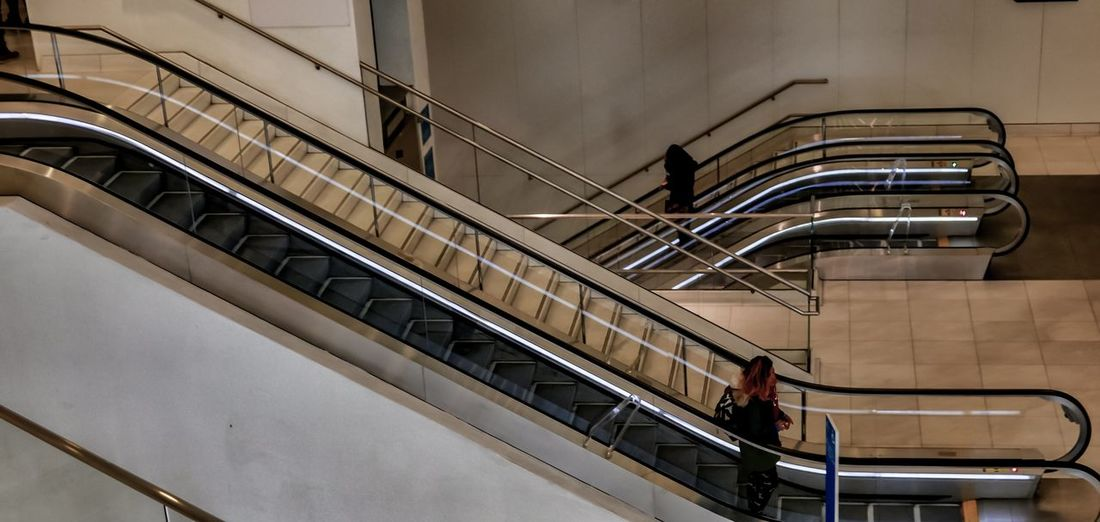 Lines And Shapes Streetphotography NYC LIFE ♥ EyeEm Selects Steps And Staircases Staircase Railing Steps Real People Escalator Architecture Built Structure Stairs High Angle View Hand Rail Walking Indoors  Men Women Day People