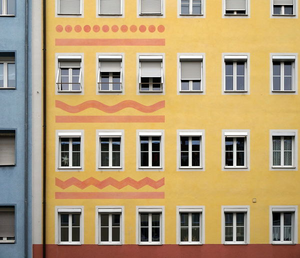 Full frame shot of yellow apartment building