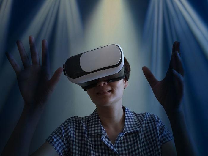 Close-up of woman wearing virtual reality simulator