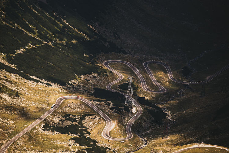 Curve Nature Road Transfagaraşan Beauty In Nature Connection Curve High Angle View Illuminated Landscape Light And Shadow Mountain Mountain Road Mountains Nature No People Outdoor Photography Outdoors Road Road Sign Roadtrip Scenics Tranquility Transportation Winding Road