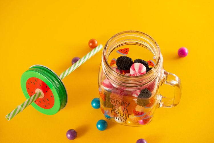 High angle view of multi colored jar on table