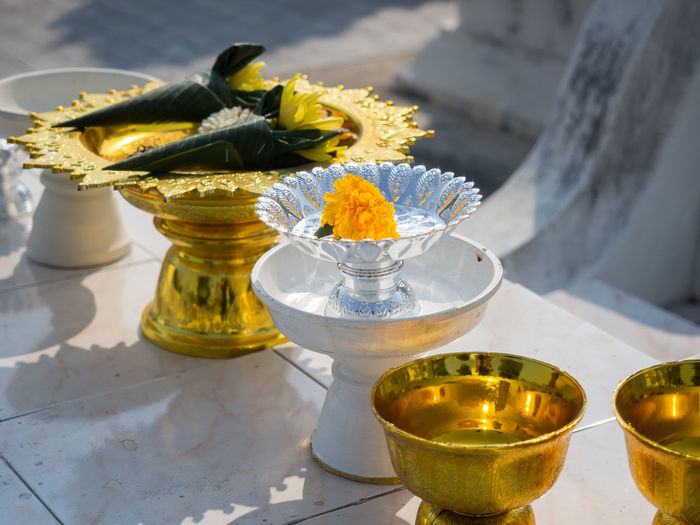 High angle view of white and golden cups at buddhist temple, chiang mai, thailand