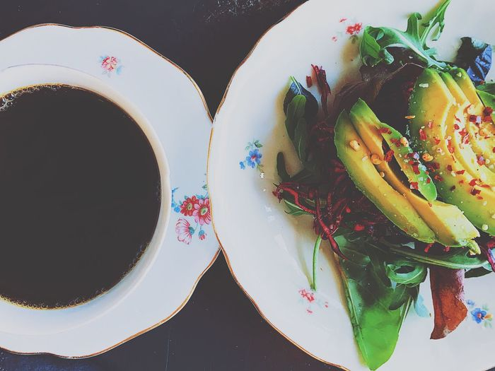 Avocado and coffee Breakfast Greens Serving Dish Serving Size Coffeecup Seasoned Chiliflakes Vegan Food Vegan Food Vegetarian Food Vegetables Vegetable Salad Avocado Top Perspective High Angle View Directly Above Indoors  No People Plate Table Food Freshness Day Close-up