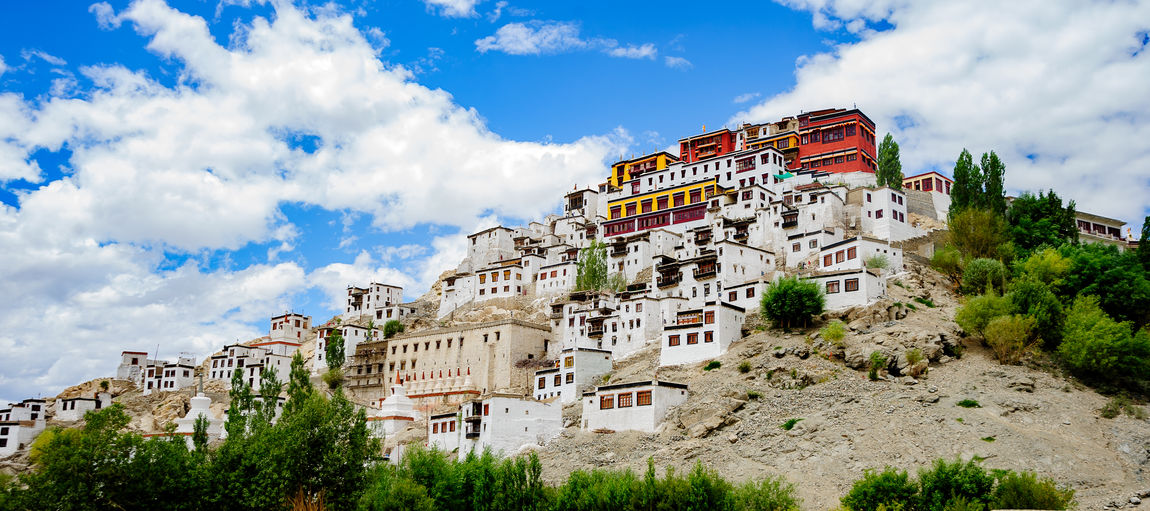 Thiksay Gompa or Thiksay Monastery is ocated on top of a hill in Thiksey village, approximately 19 kilometres (12 mi) east of Leh in Ladakh, India. The monastery is located at an altitude of 3,600 meters (11,800 ft) in the Indus Valley. Monastery Travel Architecture Buddhism Building Building Exterior Built Structure City Cloud - Sky Day Destination History Low Angle View Mountain Nature No People Outdoors Plant Religious Architecture Residential District Sky The Past Travel Travel Destinations Village