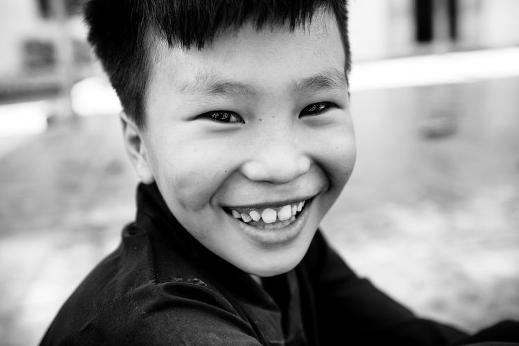 Portrait of smiling boy outdoors