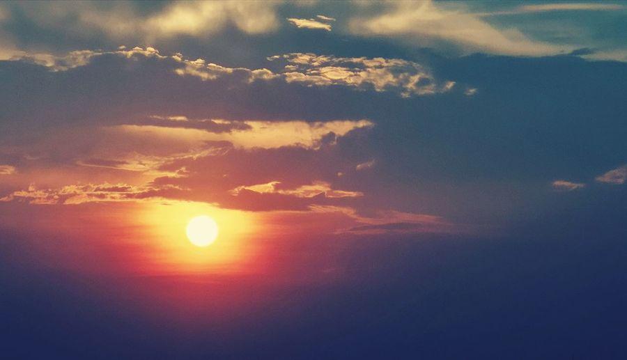 sunset and blue sky Astronomy Sunset Space Beauty Mountain Sun Sunlight Dramatic Sky Sea Sky Heaven