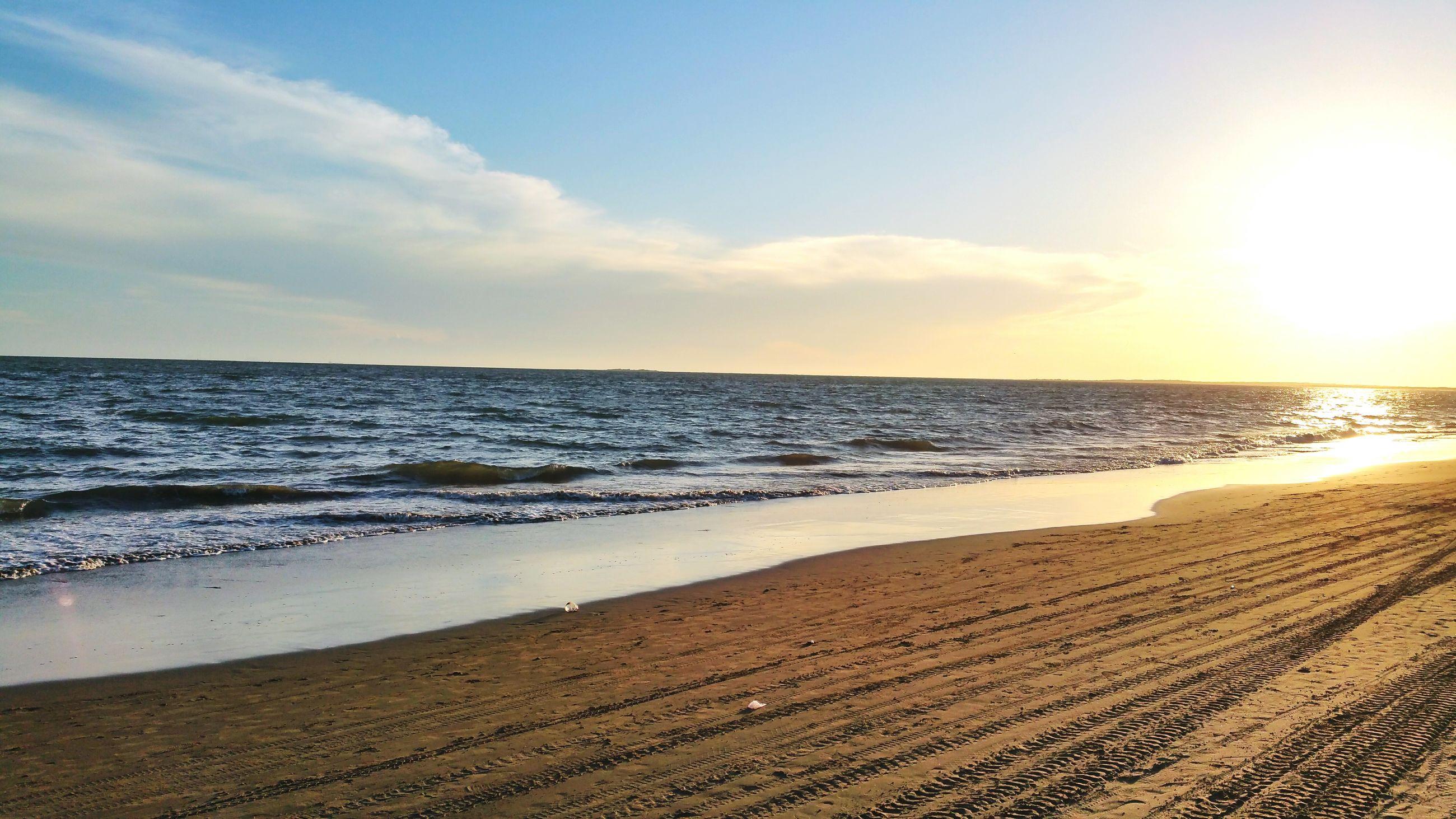 sea, beach, horizon over water, water, shore, sand, tranquil scene, scenics, tranquility, sky, beauty in nature, nature, sunset, idyllic, wave, sun, sunlight, coastline, outdoors, remote