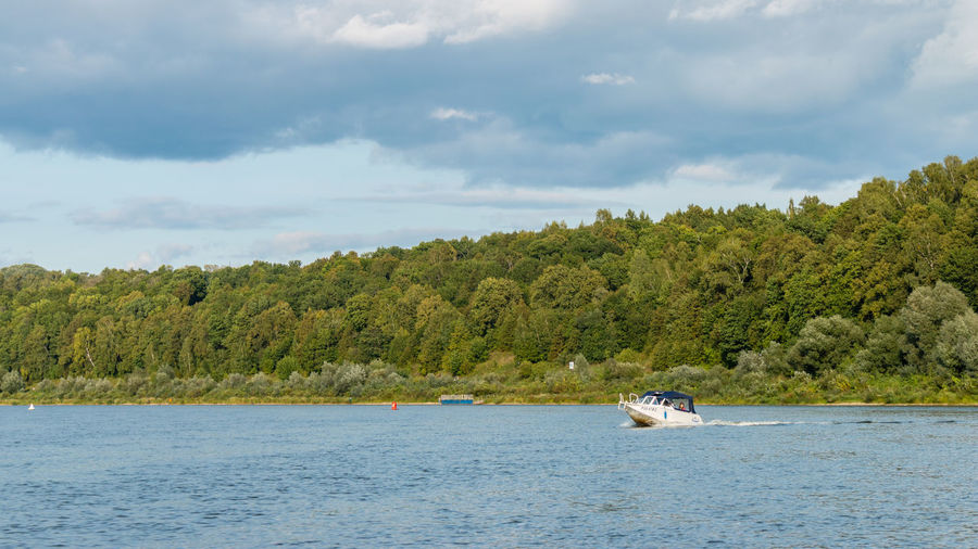 Boat on the Oka river, Russia, Polenovo Russia. Polenovo Russia Tula Oblast Beauty In Nature Boat Cloud - Sky Clouds Day Nature Nautical Vessel No People Oka Outdoors Polenovo River Scenics Sky Strakhovo Tranquility Transportation Tree Water Waterfront